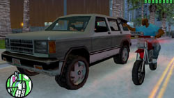 Targeting an SUV from a motorcycle in 'Grand Theft Auto: Vice City Stories'