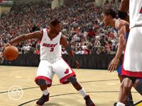 Dwayne Wade breaking down the defense at the top of the key in 'NBA Live 10' for PSP