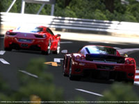 Two Ferraris playing follow the leader around a tight turn in Gran Turismo 5