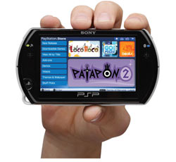 Black PSP Go, in hand and displaying the PlayStation Store