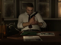 Private detective Scott Shelby looking over evidence and packing heat in Heavy Rain