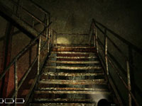 A first-person gameplay view as you head up stairs in Ju-On: The Grudge
