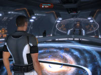Commander Shepard opening up the galaxy map in Mass Effect 2