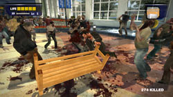 Frank West surrounded by zombies in 'Dead Rising'