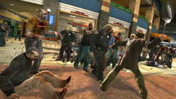 Frank West battling zombies with a frying pan in 'Dead Rising'
