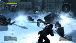 Battling the Akrid in the deep snow in 'Lost Planet: Extreme Condition - Colonies Edition'