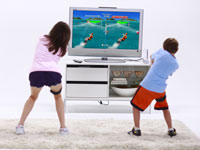Kids in multiplayer split-screen activity in EA Sports Active: More Workouts