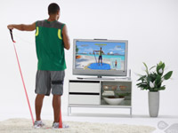 Man using the resistance bands in an arm raise exercise in EA Sports Active: More Workouts