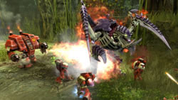 Space Marines battling a Tyranid unit in Warhammer 40,000: Dawn of War II