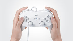 White Wii Classic Controller Pro in player's hands
