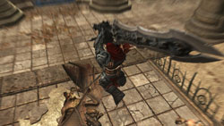 War swinging his primary weapon from above in Darksiders