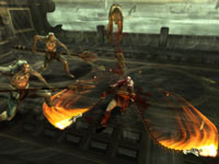 Kratos battling a horde of enemies using his chain blade weapons in God of War: Ghost of Sparta