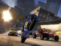 A superbike popping a wheelie to pull ahead and avoid an exploding bridge in Motorstorm Apocalypse
