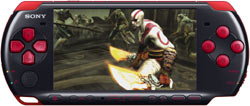 Kratos with the Blades of Athena inhand shown on the screen of a Red/Black PSP-3000