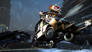 Two insanely customized vehicles catching air during combat in Twisted Metal