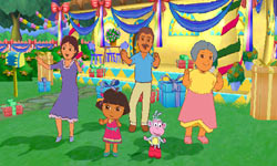 Dora's family and Boots the Monkey dancing at Dora's party in Dora the Explorer: Dora's Big Birthday Adventure