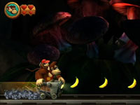 Donkey Kong and Diddy chasing bananas in a mining car in Donkey Kong Country Returns