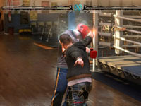 Landing a punch against an opponent in a boxing gym environment in Fighters Uncaged