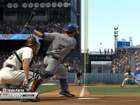 A right-handed batter lining a shot at a third baseman in MLB 11: The Show
