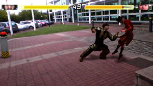 Costumed fighters battling against the backdrop of a real business park in Reality Fighters