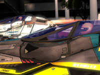 Two antigravity racing vehicles side-by-side on a race track in WipEout 2048