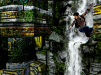 Nathan Drake descending a dangerous cliff wall in Uncharted: Golden Abyss