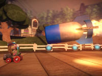 A bomb about to stop a racer in LittleBigPlanet Karting