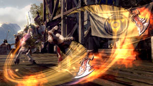 Kratos weilding the Blades of Chaos against a goat-man boss in God of War: Ascension