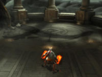 Kratos entering a large enclosure in the God of War: Origins Collection