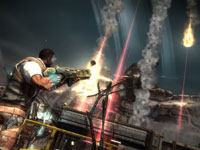 Emmett Graves fighting on the ground as an aerial bombardment levels an enemy position in Starhawk