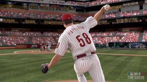 A Phillies pitcher hurling a ball from the mound in MLB 12 The Show