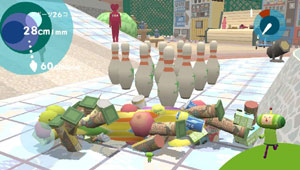 An elongated katamari about to be rolled into bowling pins in Touch My Katamari