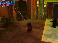 Batman and Robin teaming up to use their batterangs to move an object in Lego Batman 2: DC Super Heroes for DS