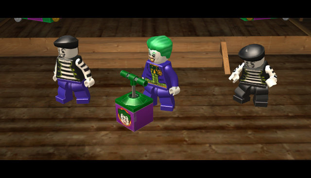 The Joker readying an explosive charge in Lego Batman 2: DC Super