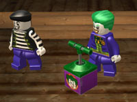 The Joker readying an explosive charge in Lego Batman 2: DC Super Heroes for PS Vita