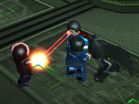 Superman using his heat vision in Lego Batman 2: DC Super Heroes for PS Vita