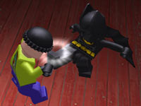 Batman kicking a henchman in Lego Batman 2: DC Super Heroes for PS Vita