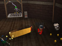 Robin throwing a weapon in Lego Batman 2: DC Super Heroes for PS Vita