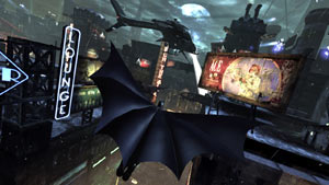 Batman gliding down from Gotham City's roofs in Batman: Arkham City