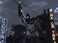 Batman using grapple tool for movement against the Gotham skyline in Batman: Arkham City