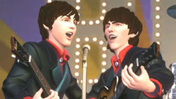 Paul and George working a harmony in The Beatles: Rock Band