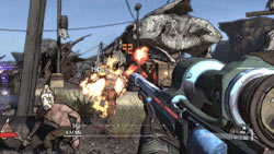 First-person perspective down a weapon barrel in multiplayer action in Borderlands
