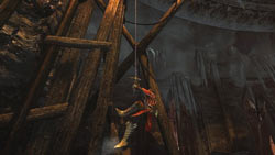 Gabriel platforming with the aid of a grapple tool in Castlevania: Lords of Shadow