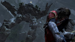 Gabriel and a huge boss in Castlevania: Lords of Shadow