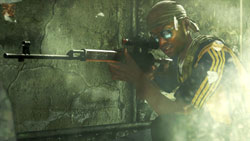 Soldier looking down a rifle with a scope attachment in 'Modern Warfare 2'