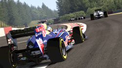 Fully licensed racing through a track in a wooded setting in F1 2011