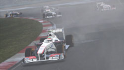 Leading the pack in a smoke covered Shanghai track in F1 2011