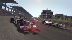 Fully licensed cars blurring into a turn in F1 2011
