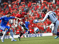 Pushing the ball into the box to challenge the goalie in FIFA Soccer 12