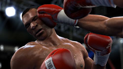 Mike Tyson taking a punch to the head from Ali in 'Fight Night Round 4'